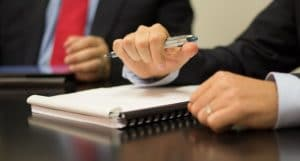 Hands of people at a meeting | selecting an employment lawyer