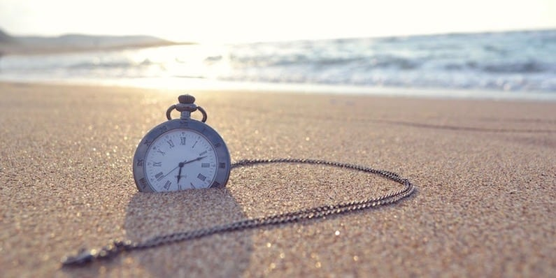 Vacation Benefits - Time clock on a beach