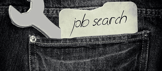Denim pocket with a wrench sticking out and and a note reading job search | Severance Pay and Employment Insurance