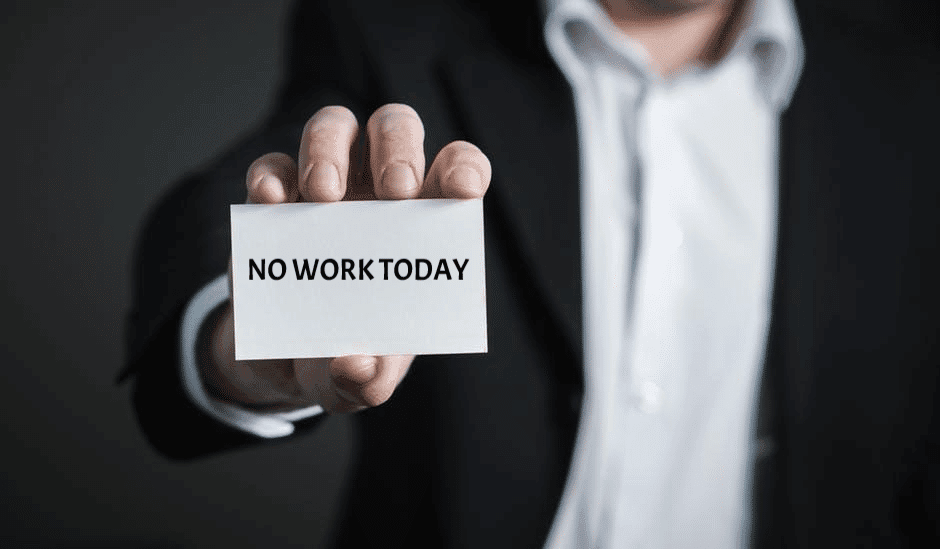 Insolvency Layoffs | Bankruptcy | torso of a man holding a sign that says no work today