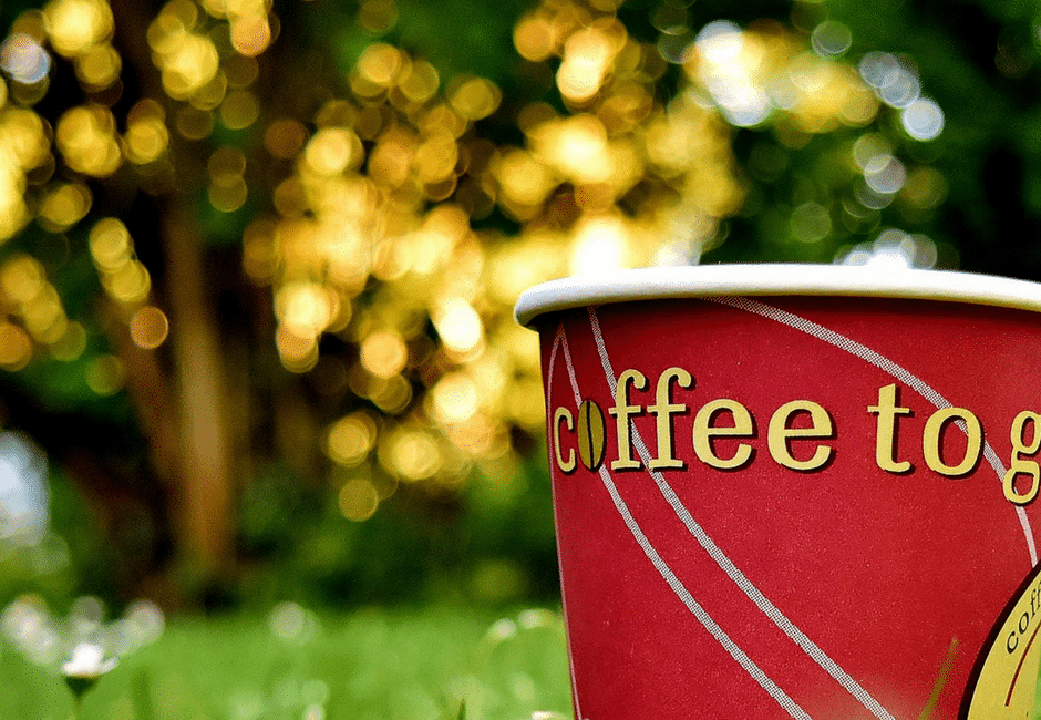 Changing Employment Terms | Red Coffee cup in the grass