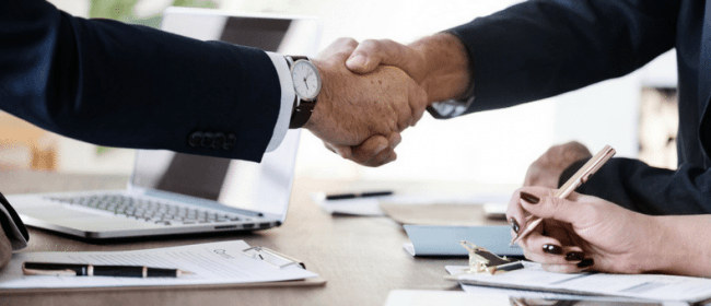 Successor Employers | A handshake Between Two men after a business deal